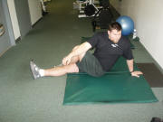 Back Stretching: Seated cross-over leg stretch