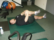 Leg Stretching: double and single leg pulls lying